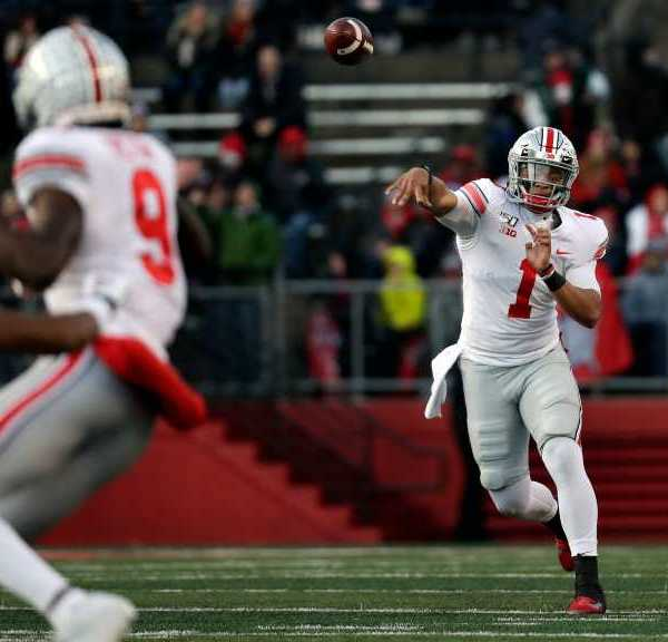 Ohio State quarterback Justin Fields (1) passes against Rutgers during the first half of an NCAA college football game Saturday, Nov. 16, 2019, in Piscataway, N.J.