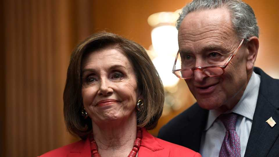 House Speaker Nancy Pelosi of Calif., left, and Senate Minority Leader Sen. Chuck Schumer of N.Y., right, listen as they wait to speak at an event on Capitol Hill in Washington, Tuesday, Nov. 12, 2019, regarding the earlier oral arguments before the Supreme Court in the case of President Trump's decision to end the Obama-era, Deferred Action for Childhood Arrivals (DACA), program.