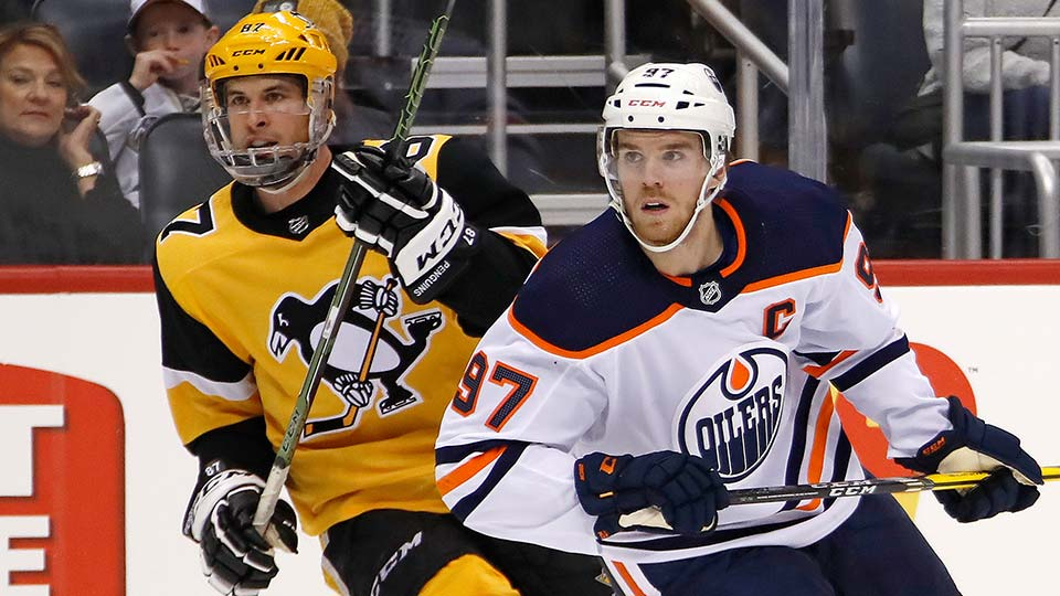 Edmonton Oilers' Connor McDavid (97) and Pittsburgh Penguins' Sidney Crosby (87).
