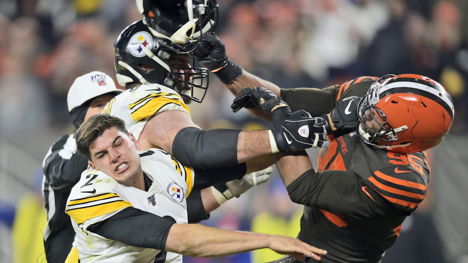 Cleveland Browns defensive end Myles Garrett (95) hits Pittsburgh Steelers quarterback Mason Rudolph (2) with a helmet during the second half of an NFL football game, Thursday, Nov. 14, 2019, in Cleveland. (AP Photo/David Richard)