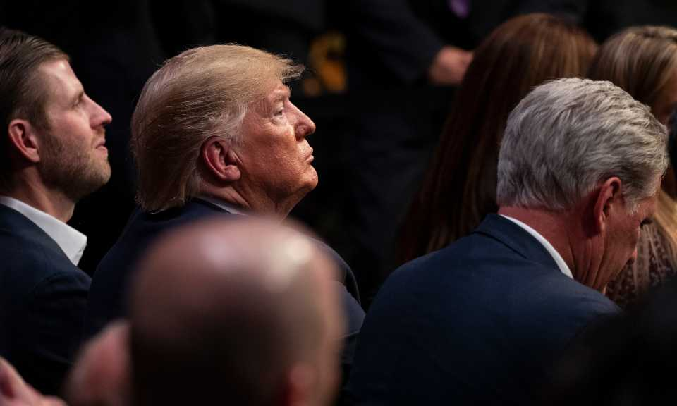 President Donald Trump watches UFC 244 mixed martial arts fights at Madison Square Garden, early Sunday, Nov. 3, 2019, in New York.
