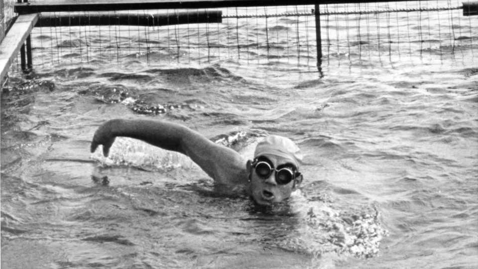 """This June 1972 file photo shows Walter Poenisch swimming during his record ocean swim 90 miles up the Florida straights in a shark cage near Miami. Faye Poenisch, whose late husband, Walter, claimed to have swum from Cuba to Florida, plans a celebration for what would have been his 100th birthday. Poenisch will have a reception Thursday, July 11, 2013, in her Grove City home to honor Walter Poenisch, who on his 65th birthday in 1978 began his swim with Cuban President Fidel Castro personally seeing him off in Havana, reportedly after a toast with pineapple juice. The retired baker and record-holding endurance swimmer called his effort the """"Swim for Peace"""" and said he completed nearly 130 miles to the Florida Keys nearly two days later."""