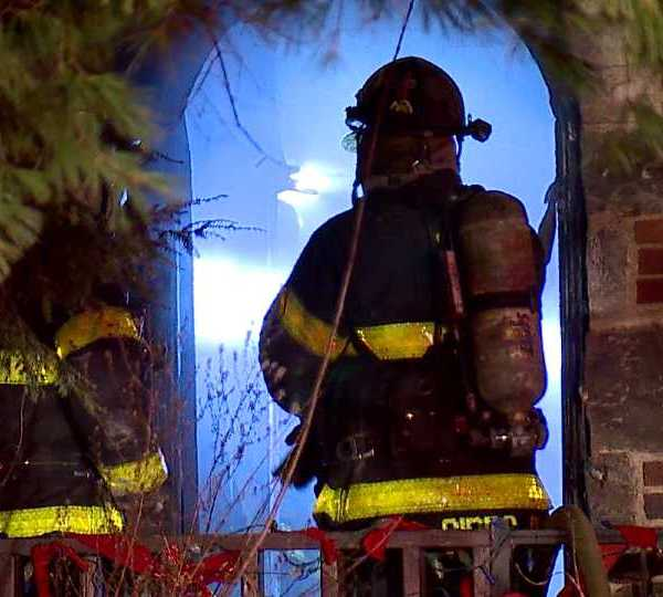 Youngstown firemen at Winona Drive house fire