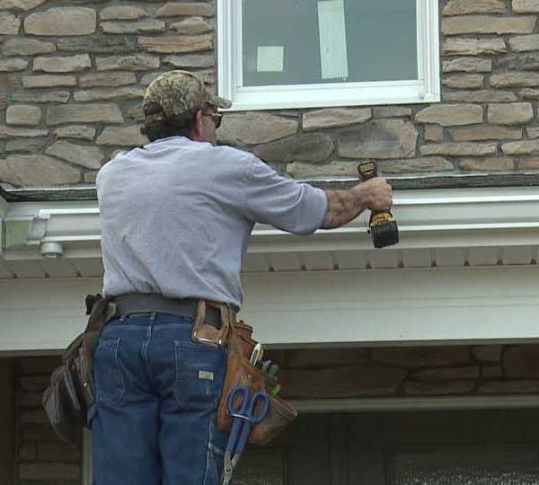 Boak and Sons do gutter work on Canfield home