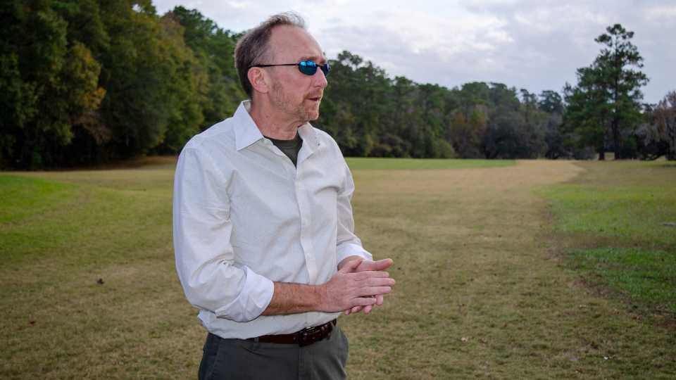 Jeffrey Shanks, an archaeologist with the National Park Service, visits an unmarked slave cemetery at the Capital City Country Club in Tallahassee.