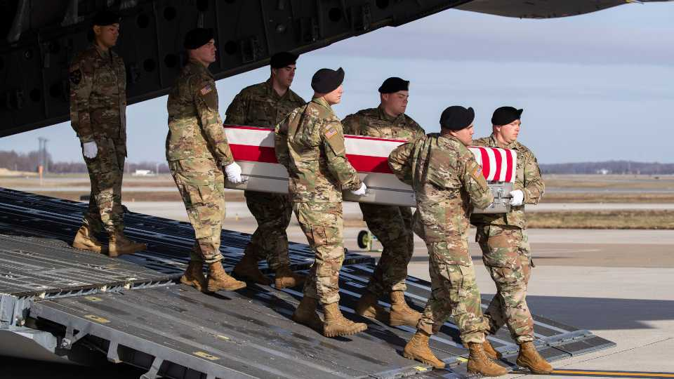 An Army carry team moves a transfer case containing the remains of U.S. Army Sgt. 1st Class Michael Goble at Dover Air Force Base.