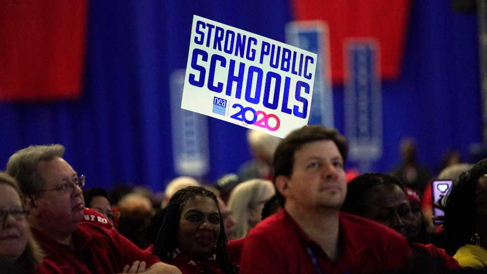 Delegates listens to Democratic presidential candidates speak during the National Education Association Strong Public Schools Presidential Forum Friday, July 5, 2019, in Houston.