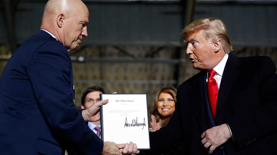 President Donald Trump shakes hands with Gen. Jay Raymond, after signing the letter of his appointment as the chief of space operations for U.S. Space Command during a signing ceremony for the National Defense Authorization Act for Fiscal Year 2020 at Andrews Air Force Base, Md., Friday, Dec. 20, 2019.