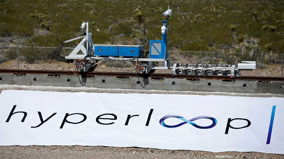 A recovery vehicle moves a sled down a track after a test of a Hyperloop One propulsion system, Wednesday, May 11, 2016, in North Las Vegas, Nev.