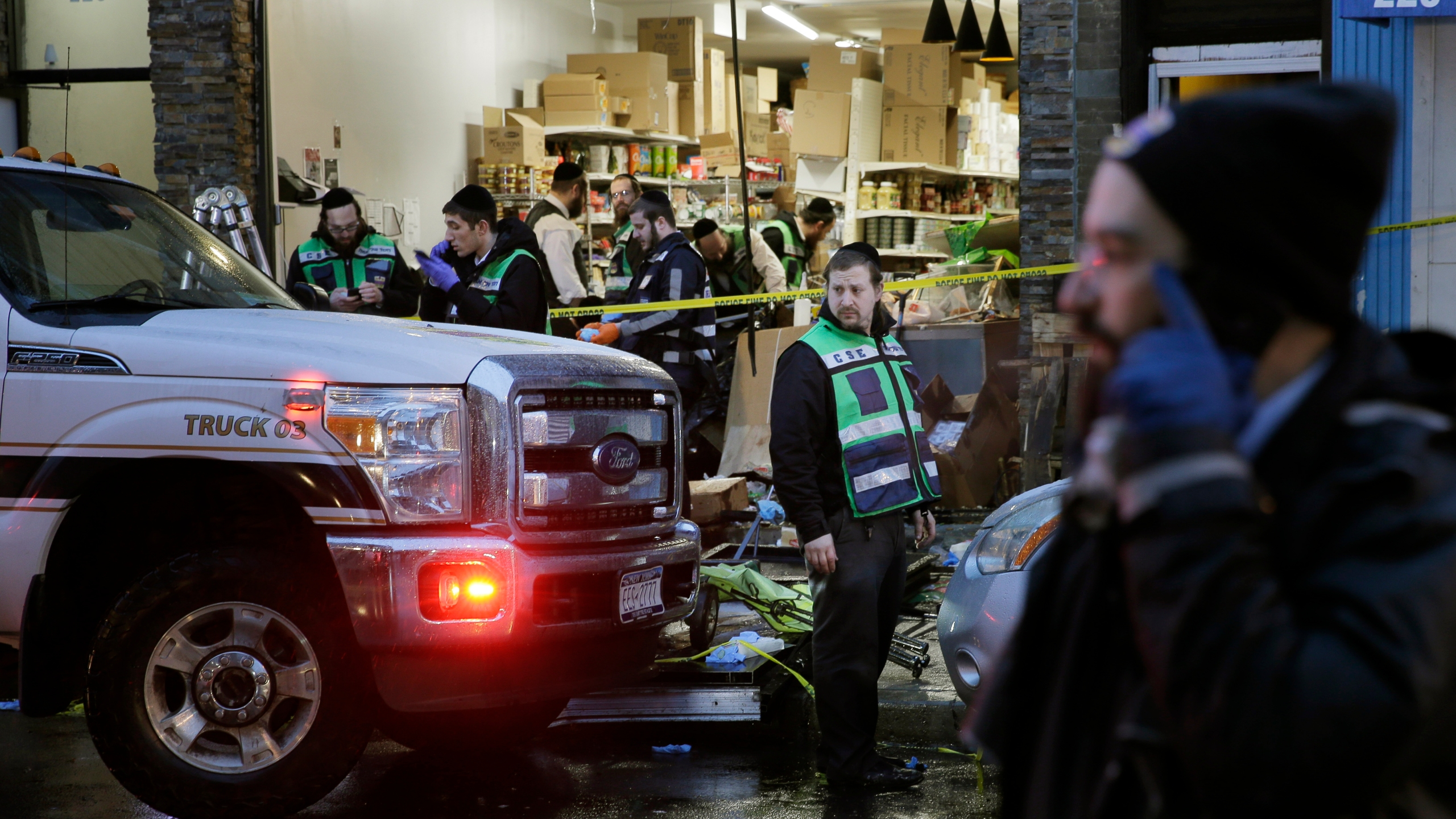 Emergency responders work at a kosher supermarket, the site of a shooting in Jersey City, N.J., Wednesday, Dec. 11, 2019. Jersey City Mayor Steven Fulop said authorities believe gunmen targeted the market during a shooting that killed multiple people Tuesday.