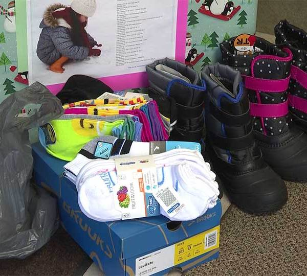 NOMS Ankle and Foot Care Centers kicked off their 22nd annual holiday shoe and sock drive.