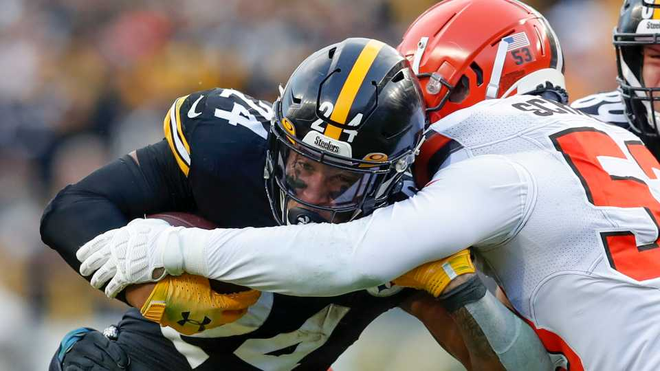 Pittsburgh Steelers running back Benny Snell (24) runs as Cleveland Browns middle linebacker Joe Schobert (53) defends in the second half of an NFL football, Sunday, Dec. 1, 2019, in Pittsburgh.