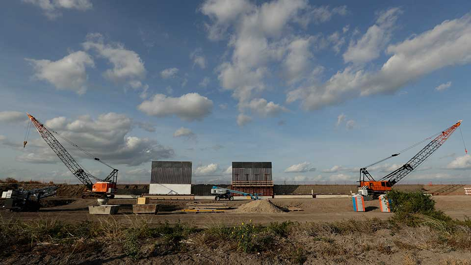 FILE - In this Nov. 7, 2019, file photo the first panels of levee border wall are seen at a construction site along the U.S.-Mexico border in Donna, Texas. A federal appeals court hears arguments against diverting Pentagon money for border wall construction as time runs out. It says the Trump administration has moved quickly to spend the money after the Supreme Court rejected an emergency appeal to prevent work from starting in July.