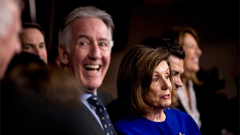 House Speaker Nancy Pelosi of Calif., accompanied by Chairman of the House Ways and Means Committee Richard Neal, D-Mass., left, and other House members, speaks at a news conference to discuss the United States Mexico Canada Agreement (USMCA) trade agreement, Tuesday, Dec. 10, 2019, on Capitol Hill in Washington.