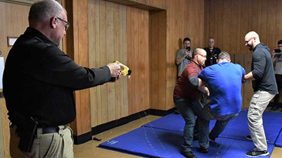 Mahoning County Sheriff's Deputy Josh Hamilton reacts just split seconds after being hit with a taser fired by Youngstown police Lt. William Ross during a recent training session at the former municipal court facility in City Hall with new members of the city police department who were just hired.