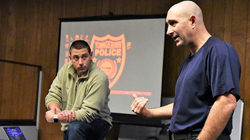 Youngstown police Lt. Brian Butler, left, listens as Capt. Kevin Mercer makes a point recently during a training session for seven new officers hired earlier this month.