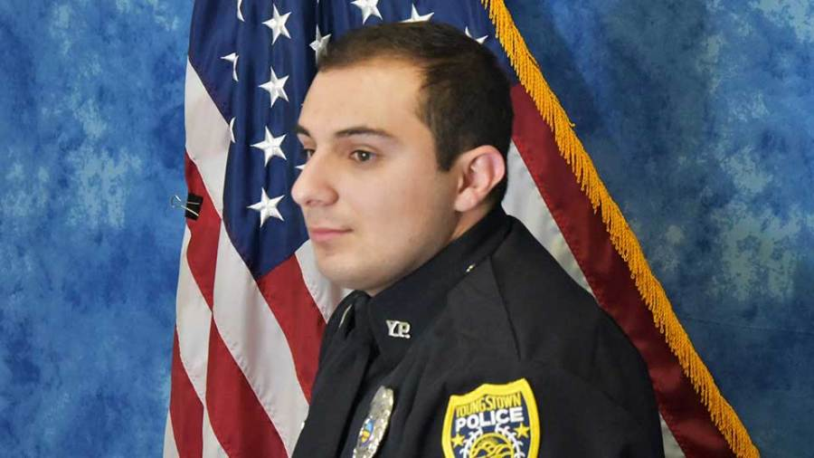 James Shirlla sits for his official portrait as a Youngstown police officer.