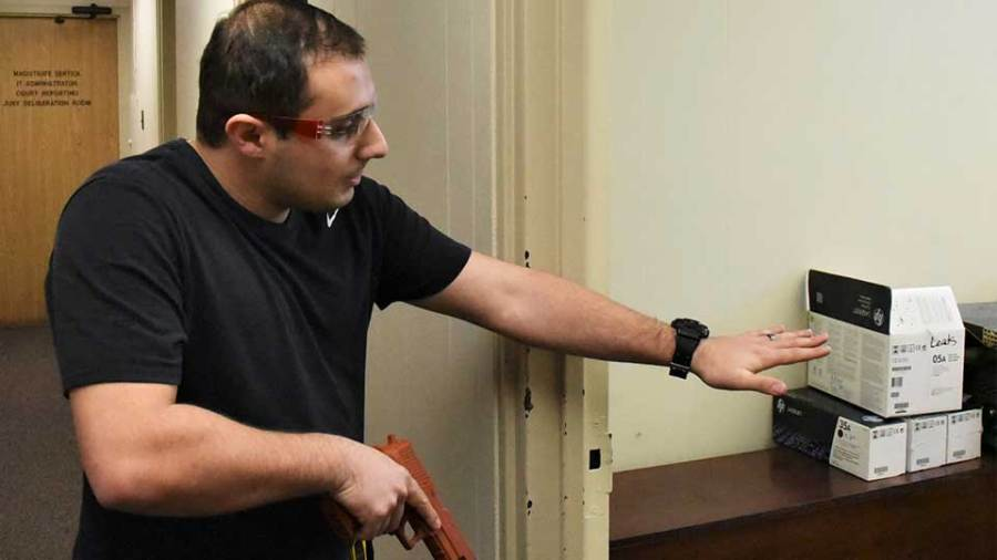 James Shirlla, a new hire at the Youngstown Police Department, checks a room for suspect recently during a training exercise for new officers in the former municipal court facility in City Hall.