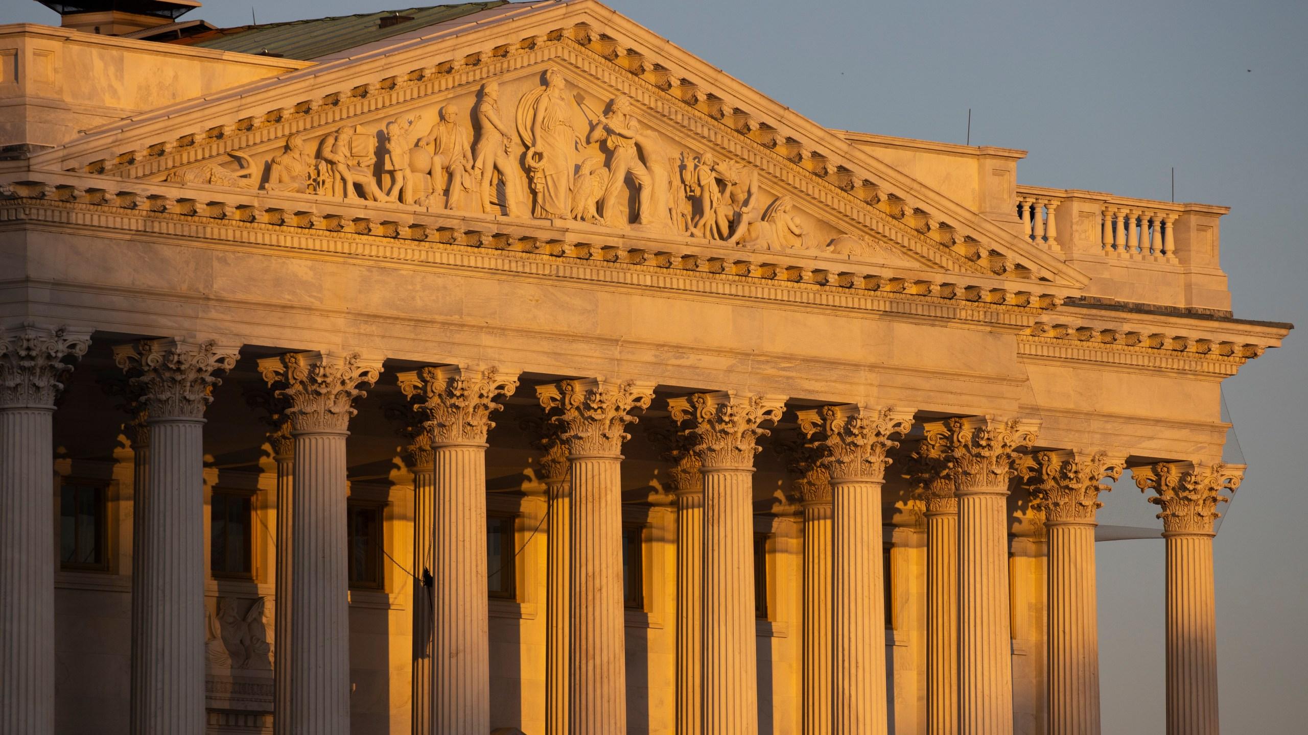 The Senate side of the U.S. Capitol at sunrise on Monday, Jan. 20, 2020
