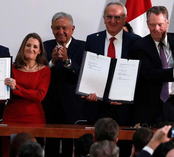 Mexico's Treasury Secretary Arturo Herrera, left, Deputy Prime Minister of Canada Chrystia Freeland, second left, Mexico's President Andres Manuel Lopez Obrador, center, Mexico's top trade negotiator Jesus Seade, second right, and U.S. Trade Representative Robert Lighthizer