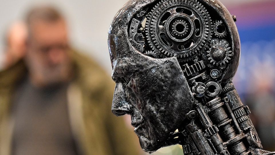 In this Nov. 29, 2019, file photo, a metal head made of motor parts symbolizes artificial intelligence, or AI, at the Essen Motor Show for tuning and motorsports in Essen, Germany.