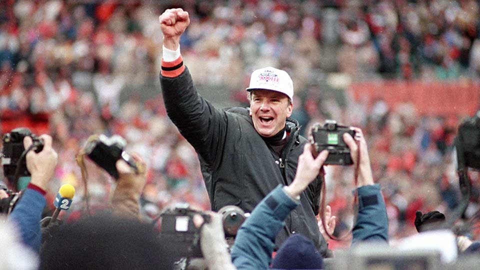 Cincinnati Bengals coach Sam Wyche stabs the air as he is carried from the field on the shoulders of his players after their 21-10 victory over the Buffalo Bills for the AFC Championship game in Cincinnati , Ohio, Jan. 9, 1989.