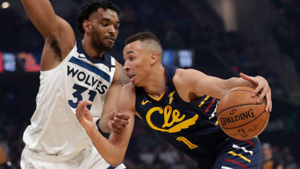 Cleveland Cavaliers' Dante Exum (1) drives past Minnesota Timberwolves' Keita Bates-Diop (31) in the first half of an NBA basketball game, Sunday, Jan. 5, 2020, in Cleveland.