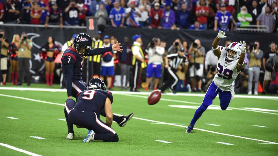 Houston Texans kicker Ka'imi Fairbairn (7) kicks a game-winning 28-yard field goal as Buffalo Bills cornerback Kevin Johnson (29) tries to block the kick during overtime of an NFL wild-card playoff football game Saturday, Jan. 4, 2020, in Houston. The Texans won 22-19.