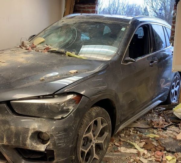 An SUV crashed into a building in Howland.