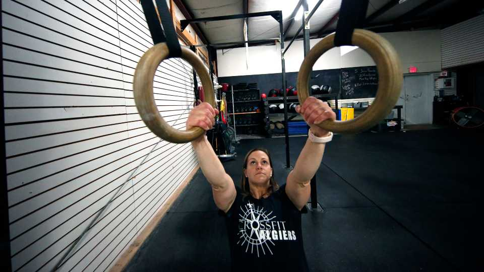 Melissa Breaux Bankston, a CrossFit athletic trainer at CrossFit Algiers in New Orleans, works out at the gym. She participates in an intermittent fasting diet.