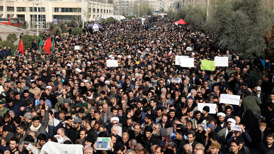 """Protesters demonstrate over the U.S. airstrike in Iraq that killed Iranian Revolutionary Guard Gen. Qassem Soleimani in Tehran, Iran, Friday Jan. 3, 2020. Iran has vowed """"harsh retaliation"""" for the U.S. airstrike near Baghdad's airport that killed Tehran's top general and the architect of its interventions across the Middle East, as tensions soared in the wake of the targeted killing."""