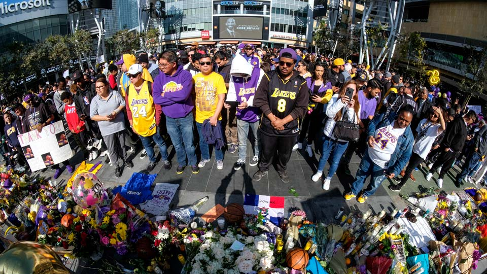 People gather at a memorial for Kobe Bryant near Staples Center Monday, Jan. 27, 2020