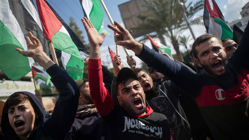 Palestinian protesters chant angry slogans during a protest against the U.S. Mideast peace plan, in Gaza City