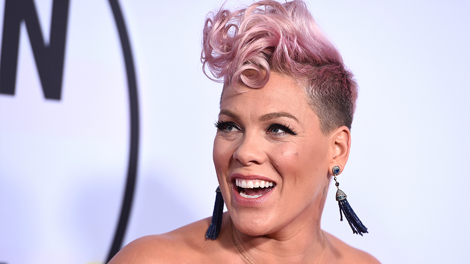 FILE - In this Nov. 19, 2017, file photo, Pink arrives at the American Music Awards at the Microsoft Theater in Los Angeles.