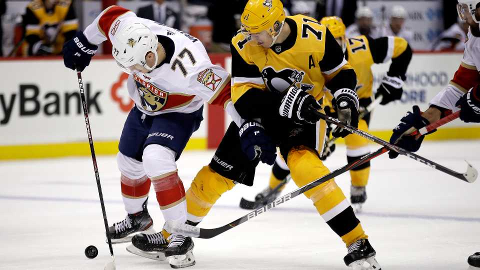 Pittsburgh Penguins' Evgeni Malkin (71) loses the puck to Florida Panthers' Frank Vatrano (77) during the second period of an NHL hockey game in Pittsburgh, Sunday, Jan. 5, 2020.