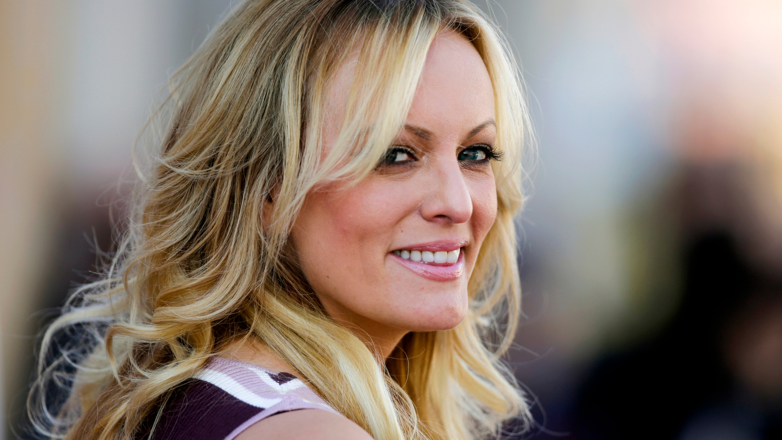 """FILE - In this Oct. 11, 2018, file photo, adult film actress Stormy Daniels attends the opening of the adult entertainment fair """"Venus"""" in Berlin."""