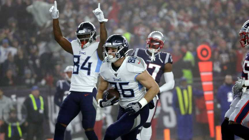 Tennessee Titans tight end Anthony Firkser, center, catches a touchdown pass against the New England Patriots in the first half of an NFL wild-card playoff football game, Saturday, Jan. 4, 2020, in Foxborough, Mass.