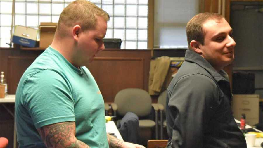 Alex Wharry, left, a new hire for the Youngstown Police Department, practices handcuffing techniques on fellow new officer James Shirlla during a training session recently at the department's training facility in the former municipal court facility in City Hall.