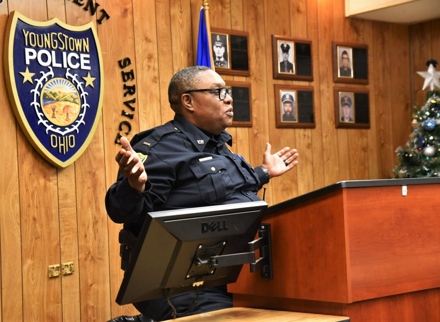Youngstown police Lt. Ramon Cox, the B-Turn, or afternoon turn commander, gestures as he talks during roll call the day after Christmas. One of the seven new officers on the department started his first day on the road on Cox's watch.