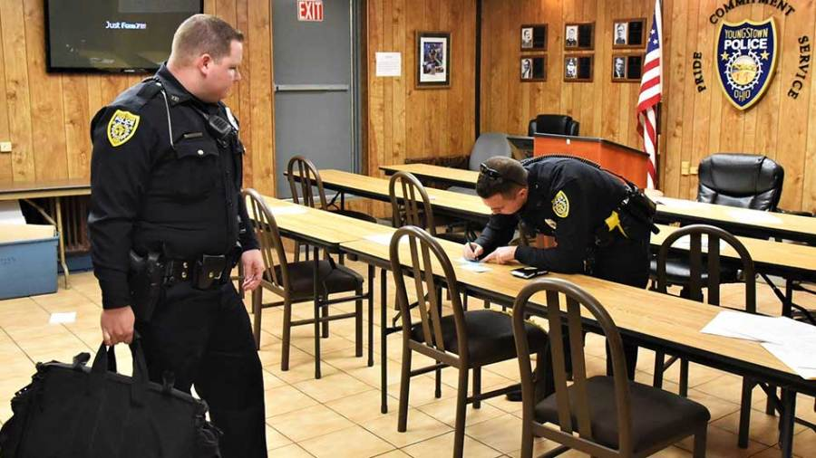 Alex Wharry, left one of seven new members of the Youngstown Police Department, waits for his partner, officer Luis Villaplana, before starting his first shift on the road the day after Christmas. Wharry will ride with a Field Training Officer on each of the department's three shifts for at least four months before being given a beat of his own.