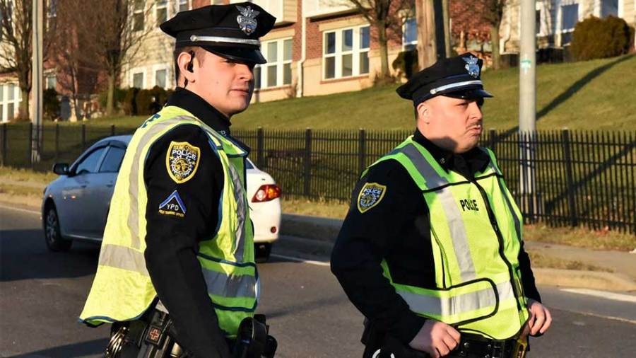 Youngstown police officers John O'Neill, left, and Dave Garcia direct traffic recently following an accident at Wirt Street and the eastbound Service Road. Garcia is one of five new hires by the department undergoing training in the field. O'Neill is his Field Training Officer.