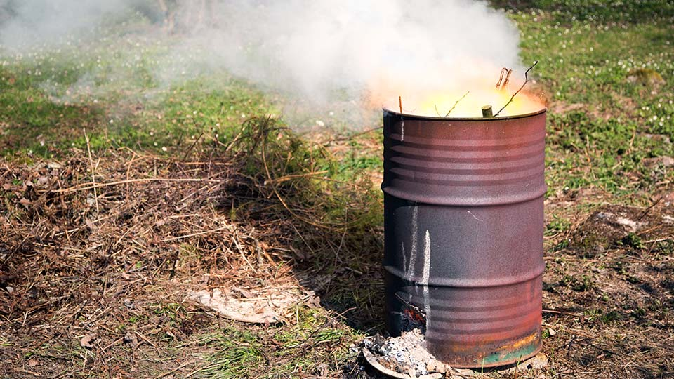 A burning barrel in use.