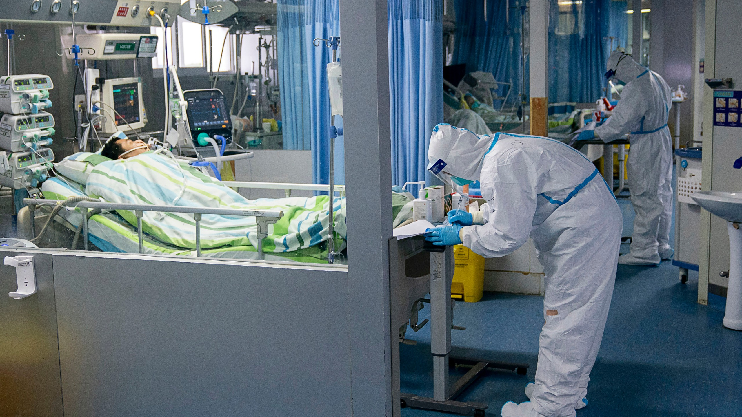 In this Friday, Jan. 24, 2020, photo released by China's Xinhua News Agency, a medical worker attends to a patient in the intensive care unit at Zhongnan Hospital of Wuhan University in Wuhan in central China's Hubei Province. China expanded its lockdown against the deadly new virus to an unprecedented 36 million people and rushed to build a prefabricated, 1,000-bed hospital for victims Friday as the outbreak cast a pall over Lunar New Year, the country's biggest, most festive holiday.