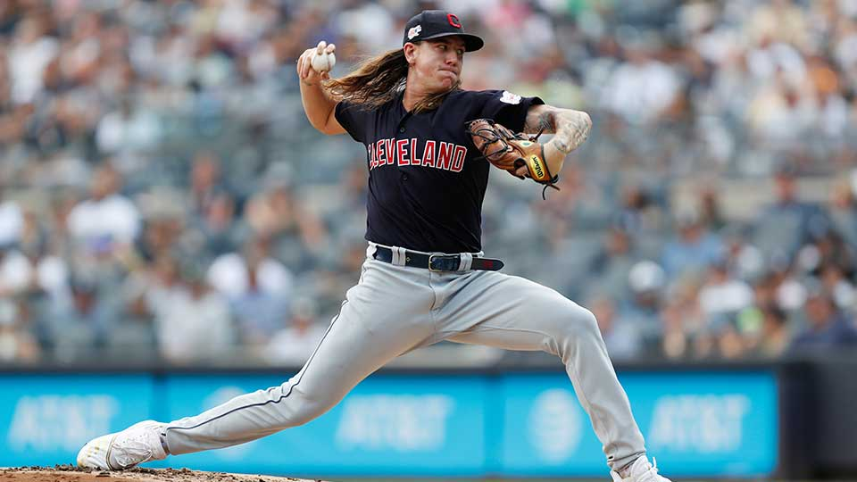 FILE - In this Aug. 18, 2019, file photo, Cleveland Indians' starting pitcher Mike Clevinger winds up during the first inning of a baseball game against the New York Yankees, in New York. Clevinger will undergo left knee surgery after injuring himself during a spring training workout. The team said Friday, Feb. 14, 2020, that Clevinger, who went 13-4 last season, suffered a partial tear of meniscus during a workout at the team's complex in Goodyear, Arizona on Wednesday.