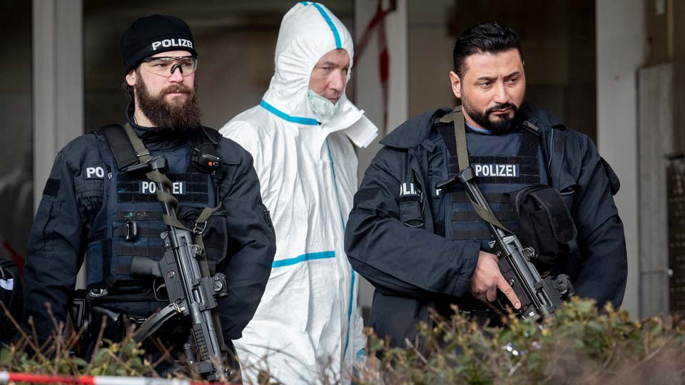 German police officers guard the entrance of a bar where several people were killed late Wednesday in Hanau, Germany
