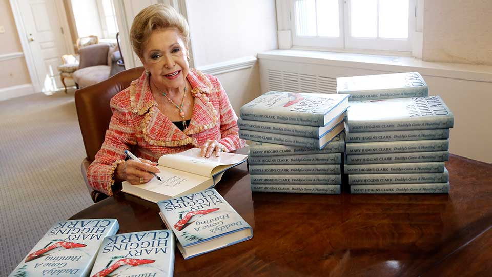 """In this Wednesday, April 3 2013 photo, author Mary Higgins Clark sign copies of her latest book """"Daddy's Gone A Hunting"""" at the Simon & Schuster office in New York. Her current book is a vintage Clark thriller featuring women in distress, mysterious pasts and secret identities. It's about a deadly explosion that destroys a family furniture business in Long Island City."""