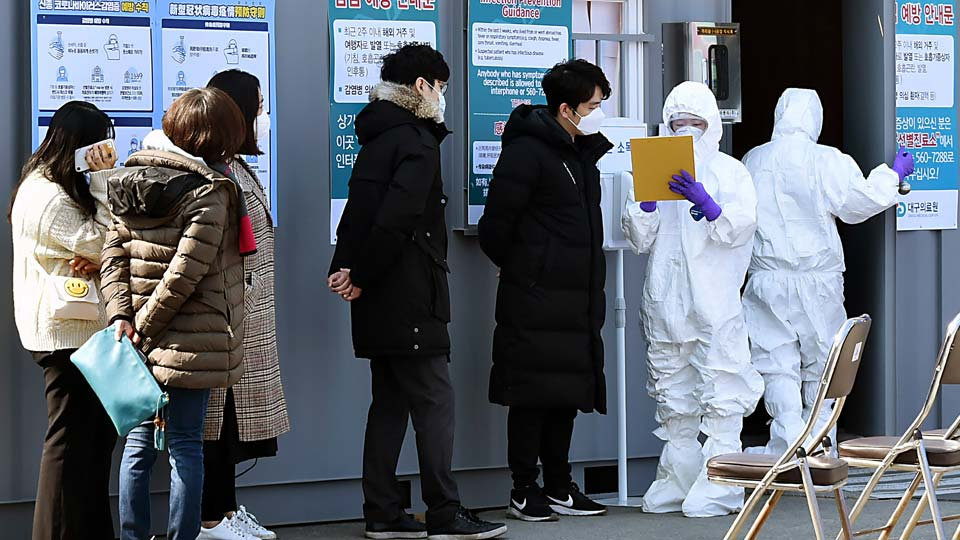 People suspected of being infected with the new coronavirus wait to receive tests at a medical center in Daegu, South Korea