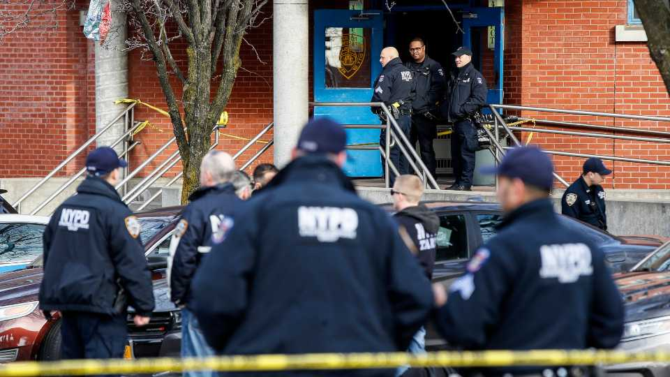 New York City police officers work the scene of a police involved shooting outside the 41st precinct Sunday, Feb. 9, 2020, in New York.