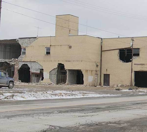 """Work started Friday to demolish the old Rexall Drug Store building at Market Street and Indianola Avenue, in the city's """"Uptown"""" neighborhood."""