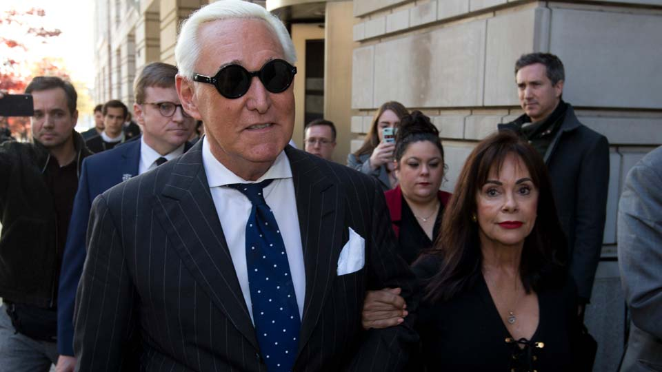 Roger Stone, left, with his wife Nydia Stone, leaves federal court in Washington